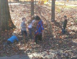 Football vs. a leaf pile