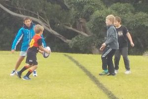 Just like an Aussie the little man got right into the mix of some rugby union action